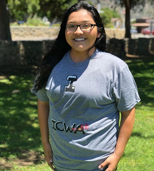 a lady wearing icwa shirt